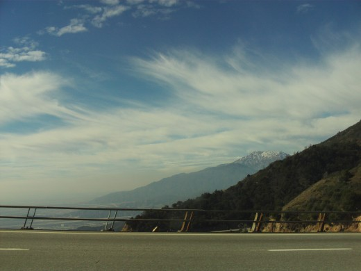 More wispy clouds, and the outline of Mount Baldy in the distance.