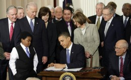 President Obama Signed The Health Care Reform Bill.