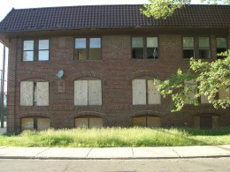 Many childhood friends and classmates used to live in this building at the corner of my street.