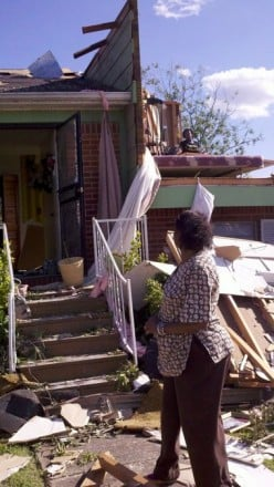 Geraldine Winchester surveys the damage to her Smithfield Estates home in Birmingham, Ala., on Thursday, April 28, 2011, which was her 70th birthday. The roof collapsed on Winchester and her husband on Wednesday night, April 27, 2011, and she escaped
