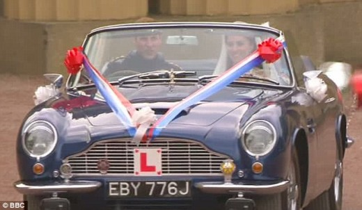 The Duke driving his new bride in an Aston Martin DB6.