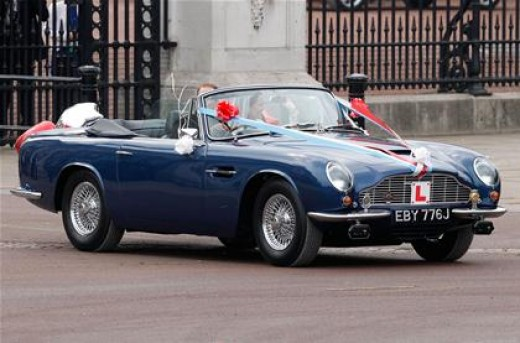 Just married: Prince William and the former Kate Middleton take a ride and wave to the crowds in a vintage Aston Martin