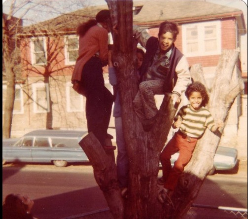 Climbing a tree for a family picture is as much fun as playing on the monkey bars.
