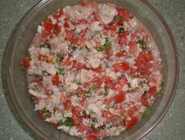 Add onion, tomato, cilantro and chili to the fish, and the Ceviche is almost done.
