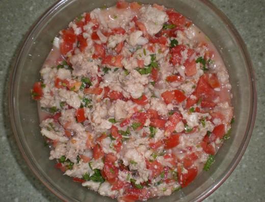 Add onion, tomato, cilantro and chili to the fish, and the Ceviche is almost done.