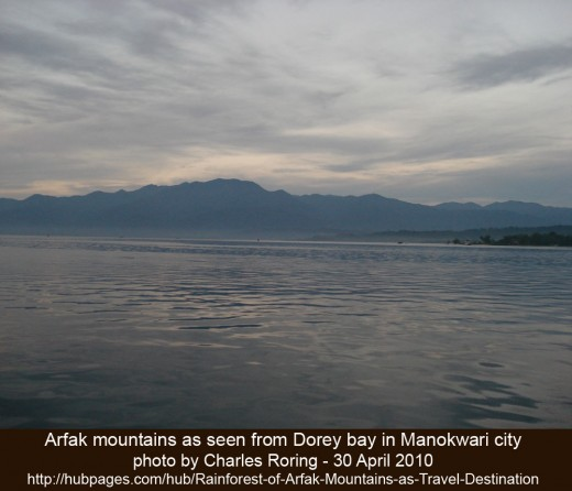 Arfak mountains early in the morning as seen from ship harbor in Dorey bay of Manokwari city