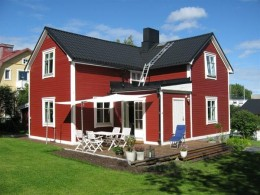 A typical Swedish house has dull reddish exterior. This color comes from a color or material in copper ore in Sweden.