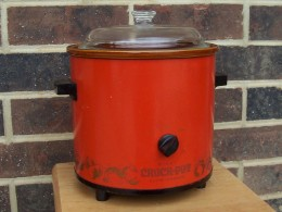 An older style crock pot. Today's crock pots are sleeker and oval.