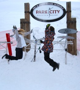 Kids jumping for joy at Park City, Utah ski resort.