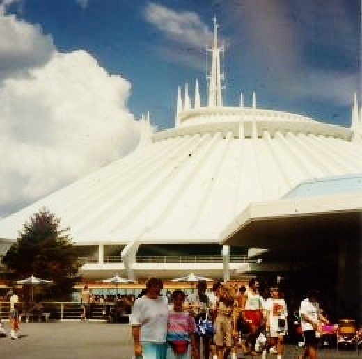 Space Mountain...a wild roller coaster ride inside this white building!
