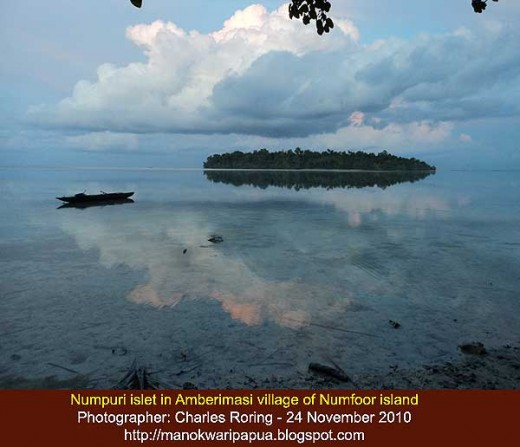 Mirror effect of a boat and Numpuri islet on the sea surface early in the morning