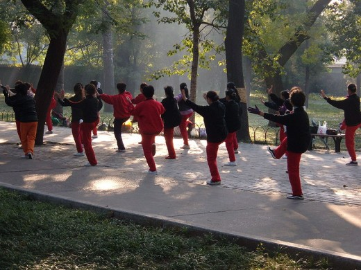 Early morning tai chi in the park not only clarifies the mind but also improves balance, thus reducing falls in older people.