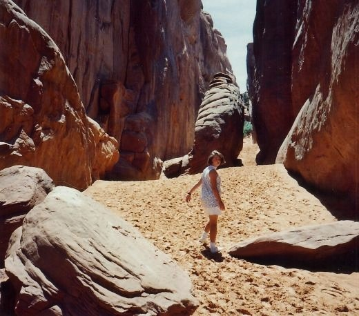 My niece walking on a trail in Arches National Park.