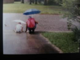 'Papa' Handlon teaching young CJ about rain.