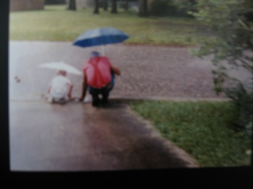 'Papa' Handlon teaching young CJ about rain.