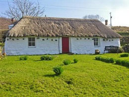 A thatched cottage, probably not unlike the one that the little girl may have lived in.