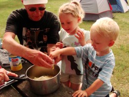 Making a pineapple upside down cake while camping.