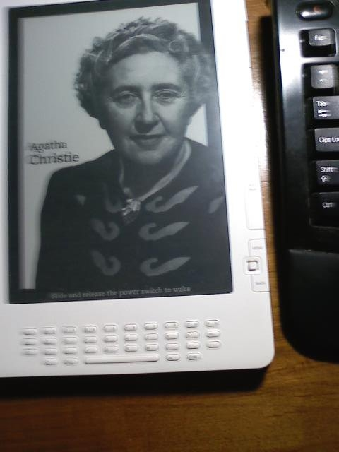 Kindle DX in Sleep Mode Offers Portraits of Famous Writers and Images of Important Books.