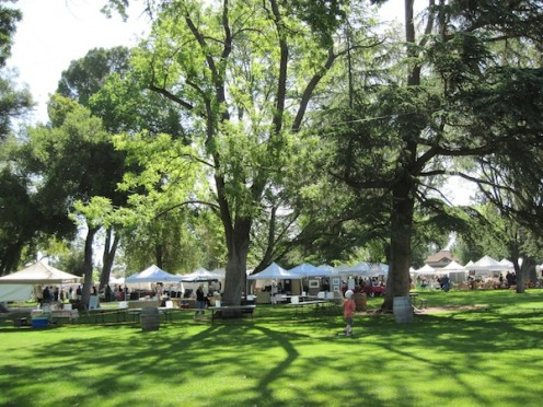 The booths toward the center in background belong to exhibitors. The empty tables in the closed area are for the wine vendors to set up by noon. Around the edges of the park are the normal Saturday Farmers Market Vendors.