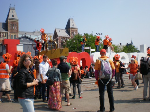 "The iconic ""I amsterdam"" at Museumplein, surrounded by celebrating crowds."