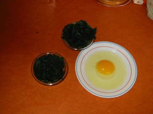 A spinach lined dish, wit eggs on the side