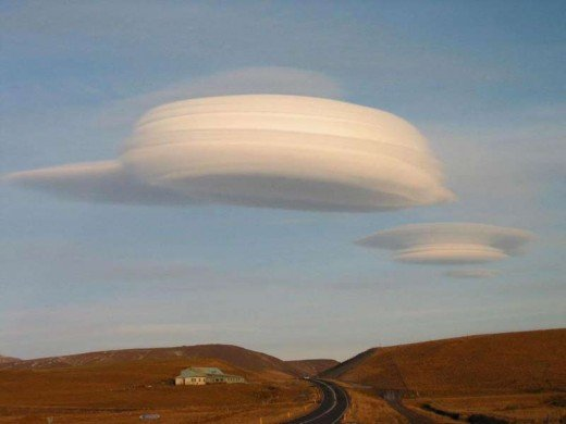 "Lenticular clouds are sometimes mistaken for the ""mother ship"" flying saucer due to their large size. However, they are nothing but clouds and are common in some areas. Check the website!"