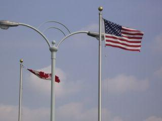 American and Canadian Flags separating the U.S. - Canadian Border on Rainbow Bridge over Niagara River.