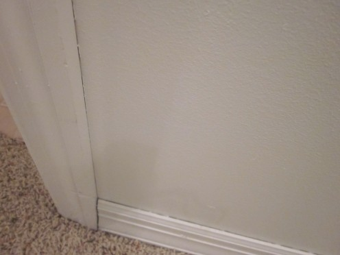 There are Gaps Where the Wall Meets the Baseboard and the Door Trim