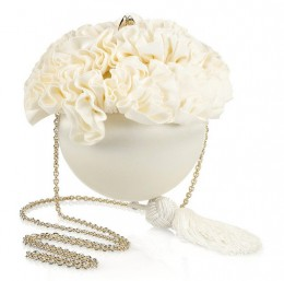 Christian Louboutin's spherical ivory satin clutch with a ruffled floral grosgrain trim is a fresh and fabulous bridal style. Carry this tasseled piece with an asymmetric off-white dress and gold lace-up stilettos for a cool, contemoporary look.