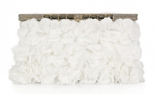 Exquisitely embellished with sheer crepe floral appliqus, Valentino's crystal-embellished white satin clutch is an elegant accessory. Carry this delicate piece to complete a glamorous bridal look.
