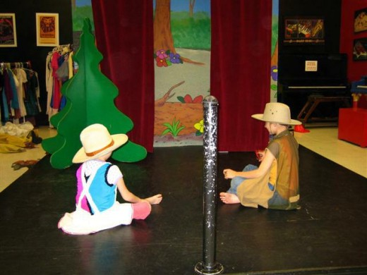 a boy and a girl playing in the theatre area. Children also have the freedom to dress up.