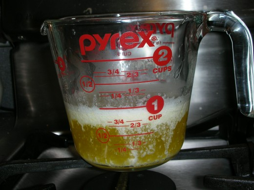 Melted butter in measuring cup