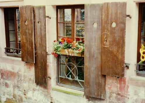 Window boxes planted with flowers are frequently seen.