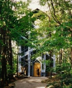 Thorncrown Chapel surrounded by a wooded setting