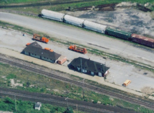 The Burlington CN Railway Station (building on right) (about 1999) and a maintenance building on left side before construction of the thrid railway track. The Burlington Train Station (also called Freeman Station) was moved in 2004 from this location