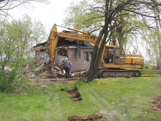 Ground photo of me standing beside the last cottage to be demolished, 1184 Lakeshore Rd., (2004) to make way for Beachway Park.
