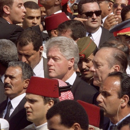 US President Bill Clinton (C) and French President Jacques Chirac (R) walk behind the casket of Morocco's King Hassan II 25 July, 1999 through the streets of Rabat, Morocco. The Clintons are in Morocco to attend the funeral of Morocco's King Hassan I