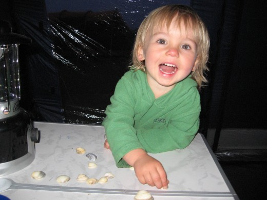 In the tent at night, playing with shells we found on the beach.