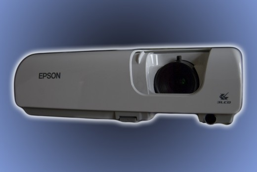 The epson Powerlite-frontal view with a sliding lens protector which securely protects the lens from dust and scratches when not in use