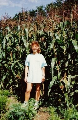 My niece standing in an adjacent field of corn grown on the James farm.