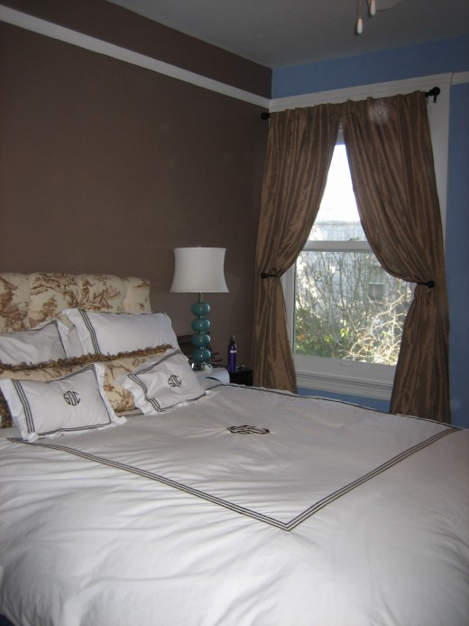 Try painting the wall behind a bed a different color from the rest of the room.