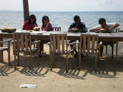 Enjoying coconuts at Nirwana beach.