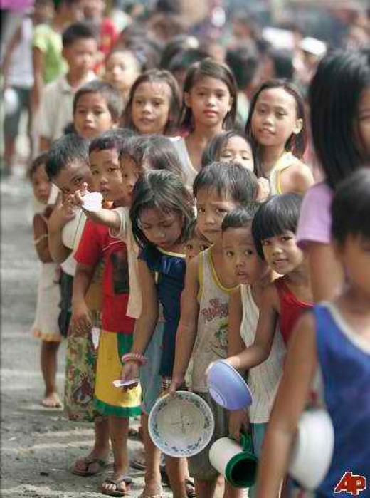 Filipino Children lining up for free food