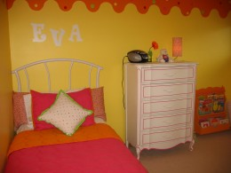 Letters on the wall and lamp on the dresser serve as cute yet inexpensive accent pieces.