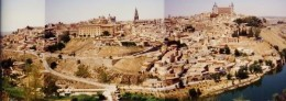 Three photos pieced together showing a good view of Toledo as seen from a distance.