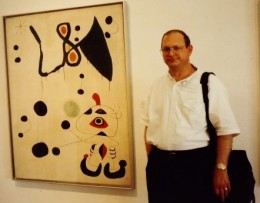My hubby standing next to a Miro painting.