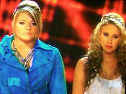 It was between Lauren and Haley.  Ryan announced that Lauren is going to the finale.  Haley got eliminated - American Idol 2011 Top 3 Results May 19, 2011