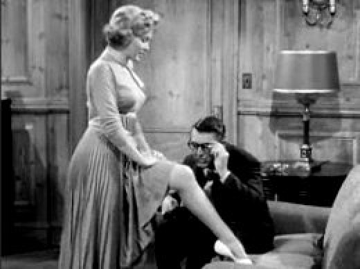 """Marilyn Monroe flirting with Cary Grant in the film, """"Monkey Business"""" (1952). But Mr. Grant's character is missing the clues being offered."""