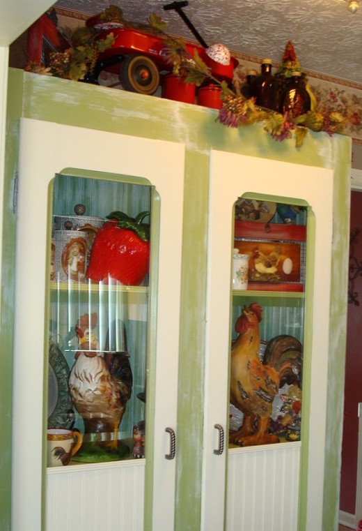 Restore an old cabinet to create the perfect display for your Rooster Decor collection