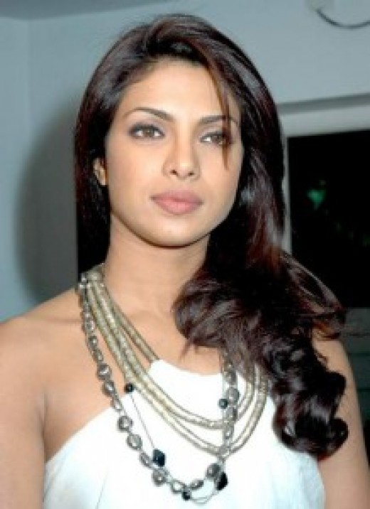 Priyanka Chopra in a White dress with bead necklace